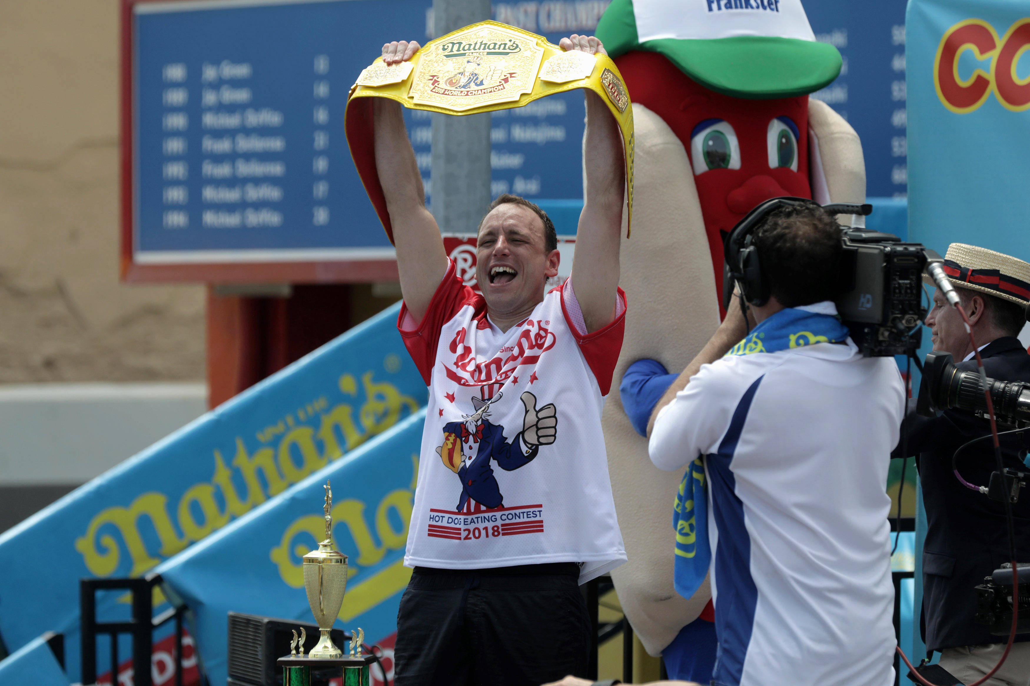 Joey Chestnut wins the annual Nathan's Hot Dog Eating Contest, setting a new world record by eating 74 hot dogs in Brooklyn, New York City